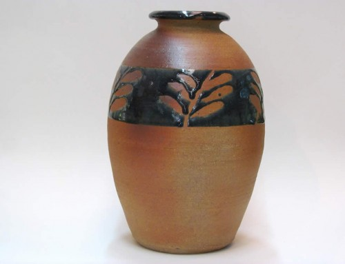 Wax decorated urn