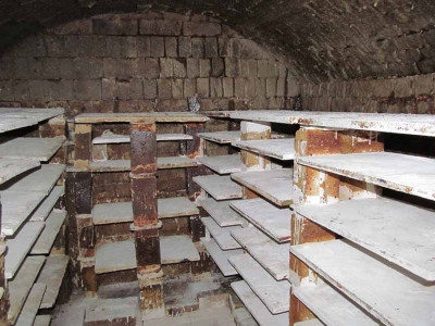 Showing the permanent shelves in the kiln – the gap in the middle will be filled by the shelves on the trolley The shelves are supported by a framework of full or half bricks so that no support structure weight rests on the shelves themselves.